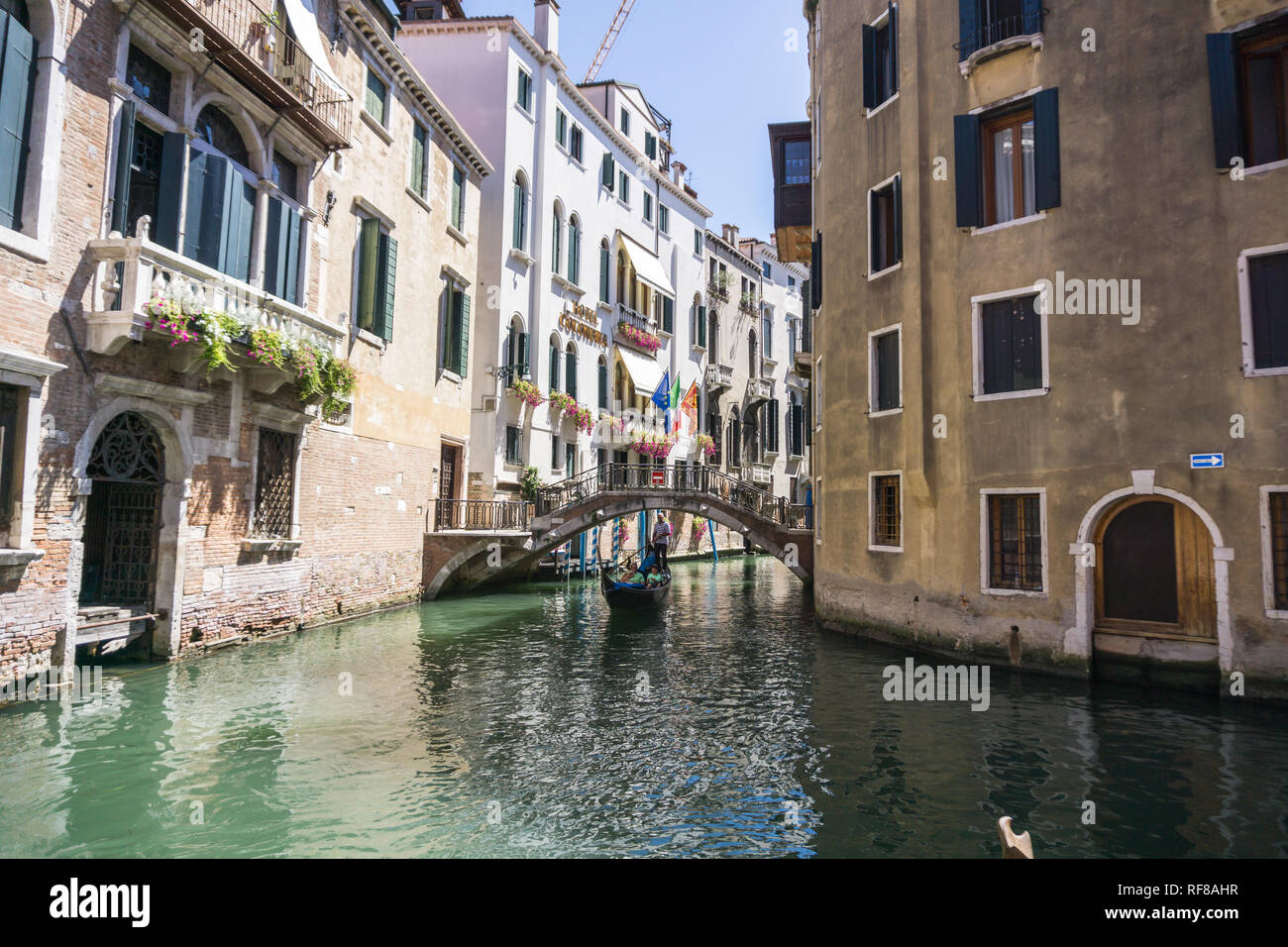 View of the Rio Marin Canal with boats and gondolas from the Ponte de la Bergami in Venice, Italy. Venice is a popular tourist destination of Europe. VENICE, ITALY - 14.8.2017 Stock Photo