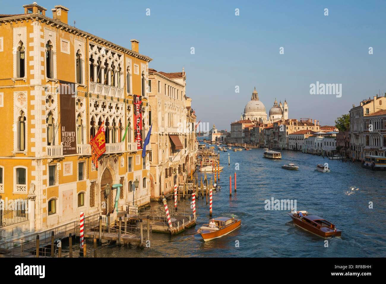 Water taxis and vaporetto on Grand Canal with Renaissance architectural style palace buildings in San Marco and Santa Maria - Stock Image