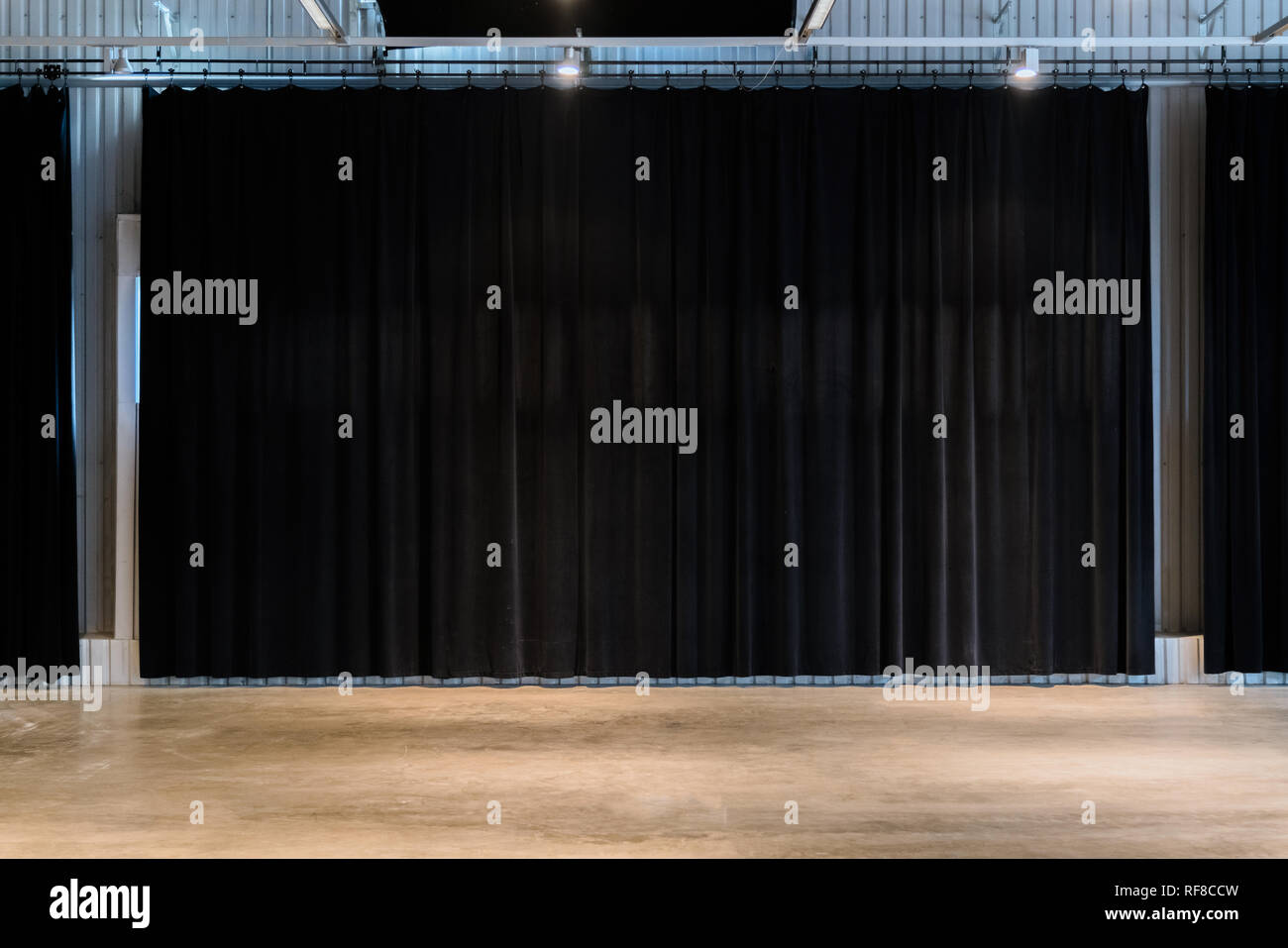 Black movie theater curtains with concrete floors. Empty spare for performance Stock Photo