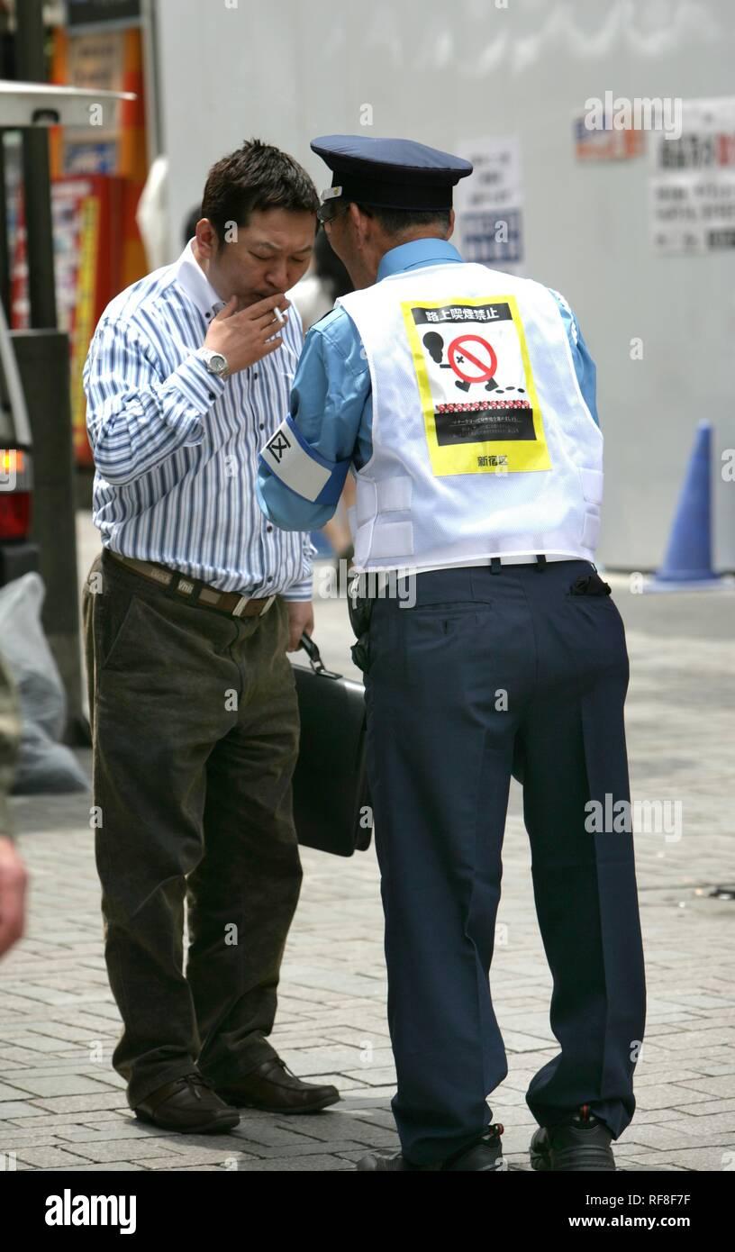 Japan, Tokyo: Anti-smoking officer on the streets of Shinjuku. - Stock Image