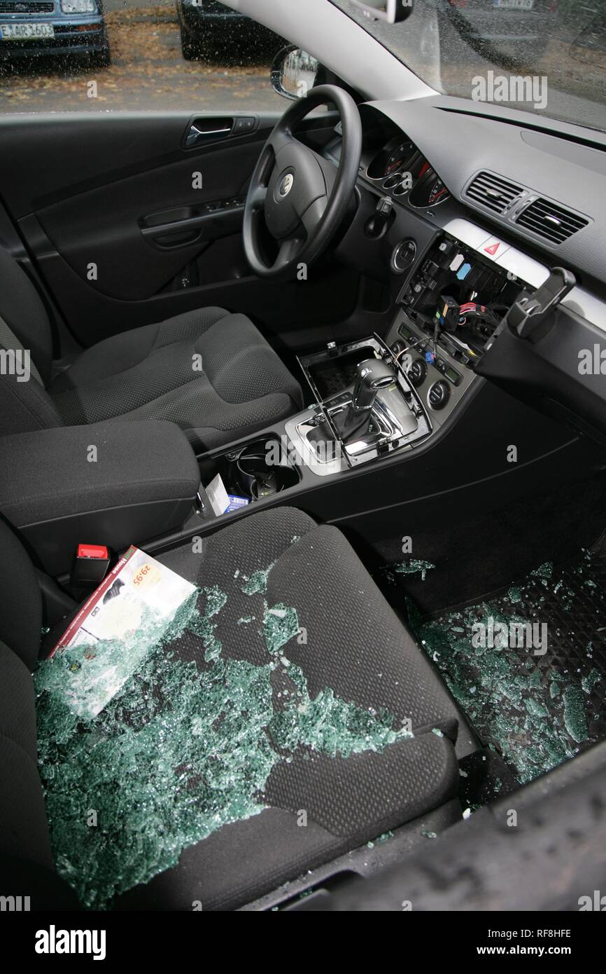 Broken-into car from which thieves have stolen a radio and navigation system, Essen, North Rhine-Westphalia - Stock Image