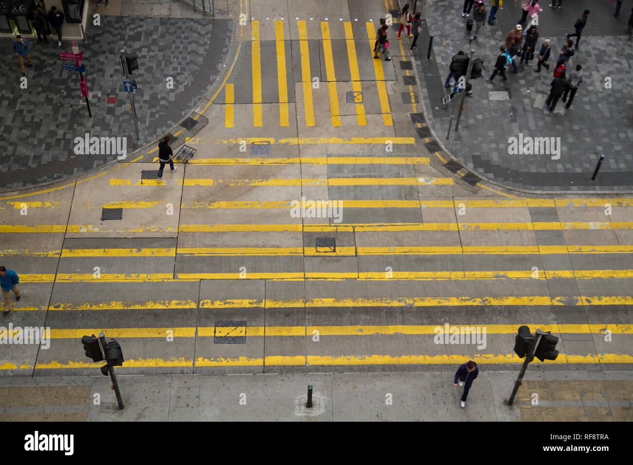 High view down to street crosing yellow markings Hong Kong - Stock Image