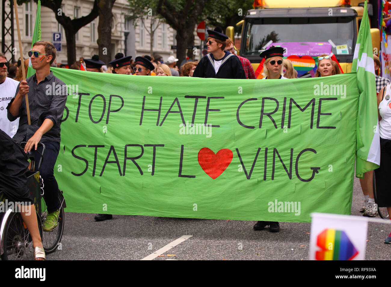 Copenhagen, Denmark - August 18. 2018: Stop hate crime demonstration - people carrying a banner - Stock Image