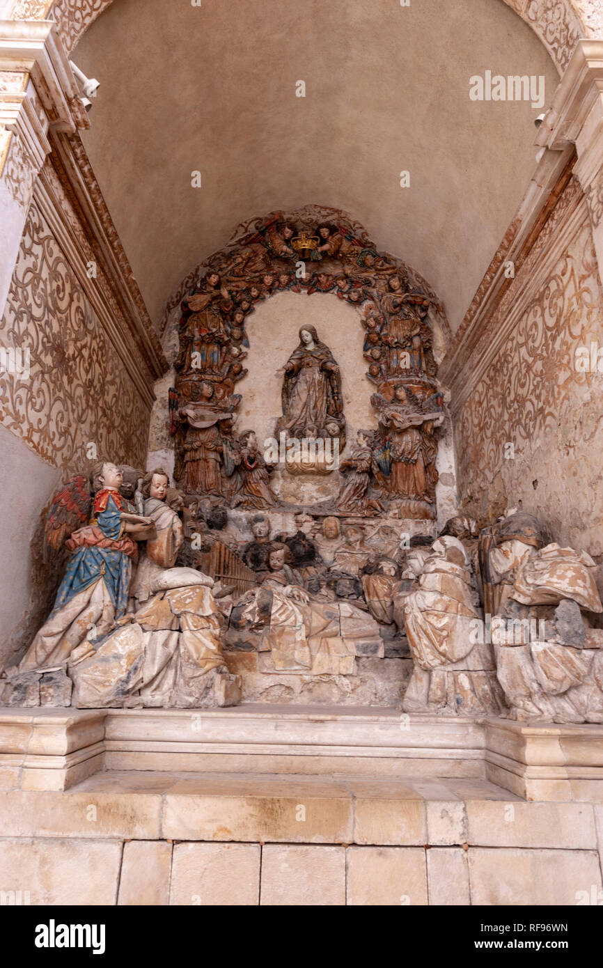 Polychrome sculpture of the Madonna in Chapel of Saint Bernard and sculptural group depicting the 'Death of Saint Bernard',in  Alcobaça Monastery - Stock Image