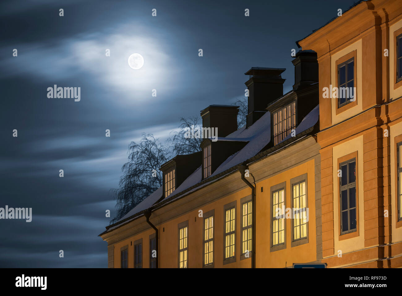 Full moon and old buildings in Central Uppsala, Sweden, Scandinavia. - Stock Image