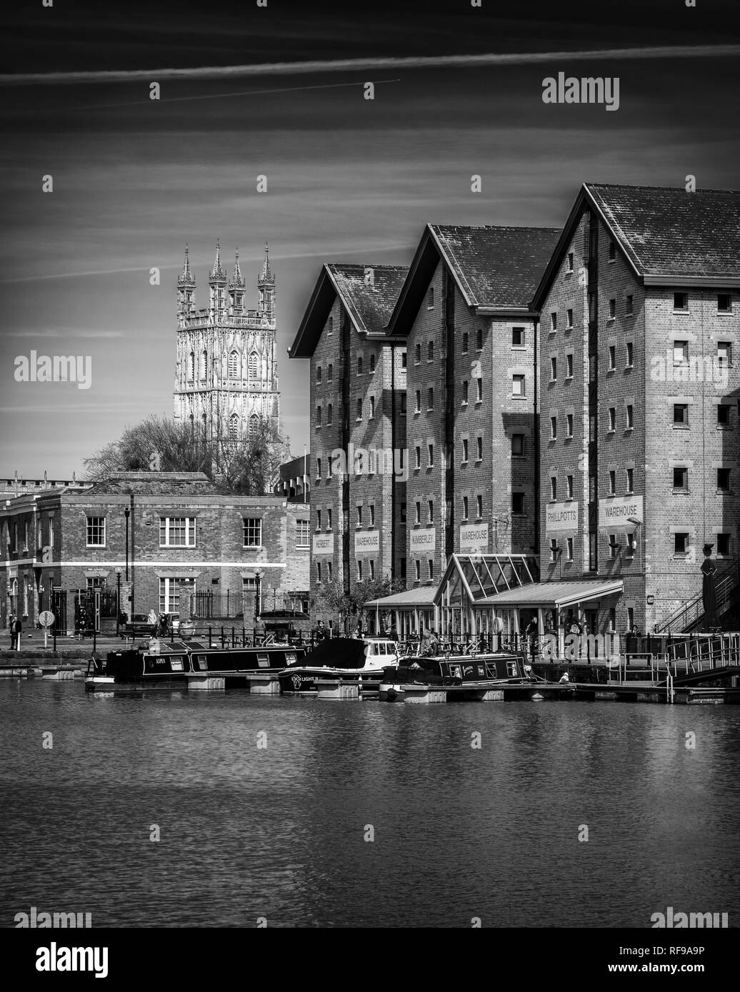 Victorian Warehouses at Gloucester Docks with the Cathedral tower in the background Stock Photo