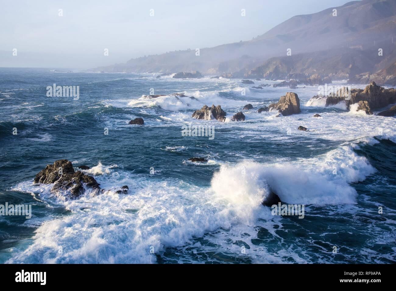 Crashing waves and rocky shores of the Monterey Peninsula. - Stock Image