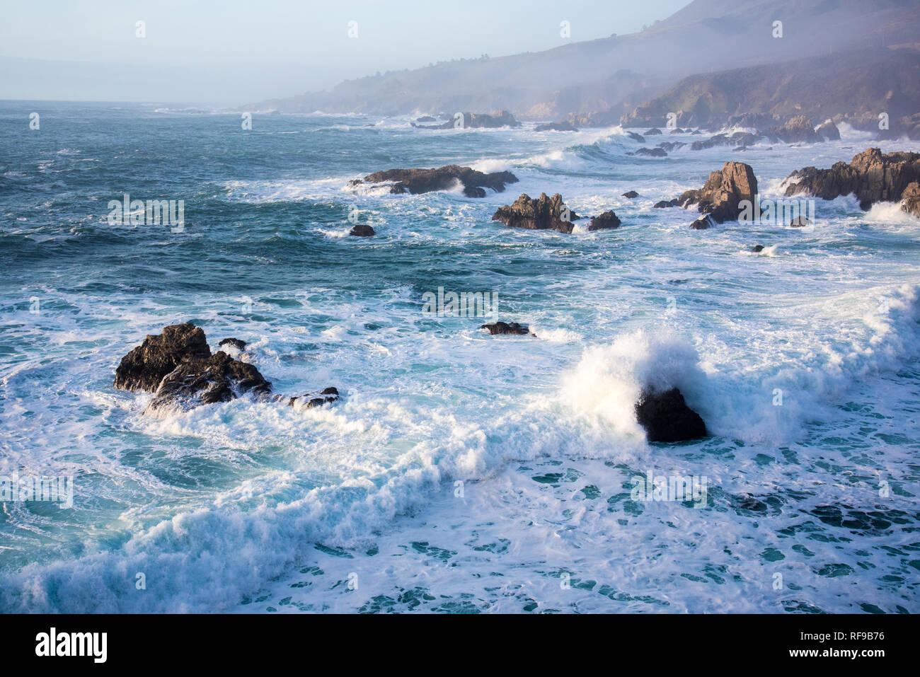 Crashing waves and rocky shores of the Monterey Peninsula. Stock Photo
