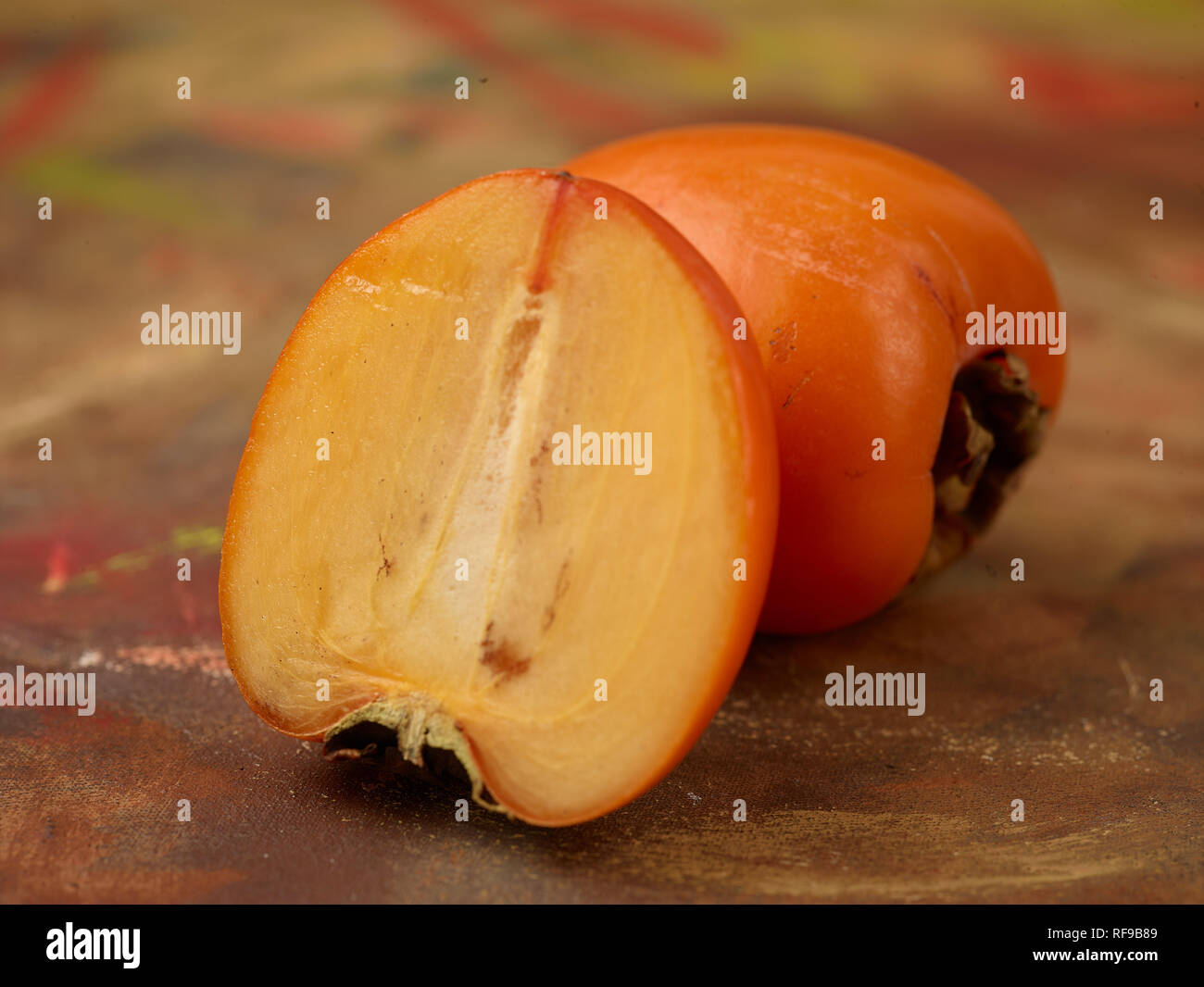 Persimmon, Sharon fruit, food still-life photograph - Stock Image