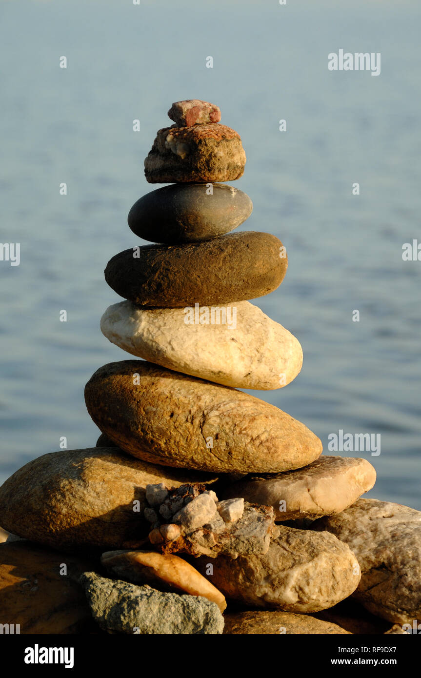 Rock Balancing, Stone Balancing, Stone Stack or Rock Stack Earth Art in the Camargue Provence France - Stock Image