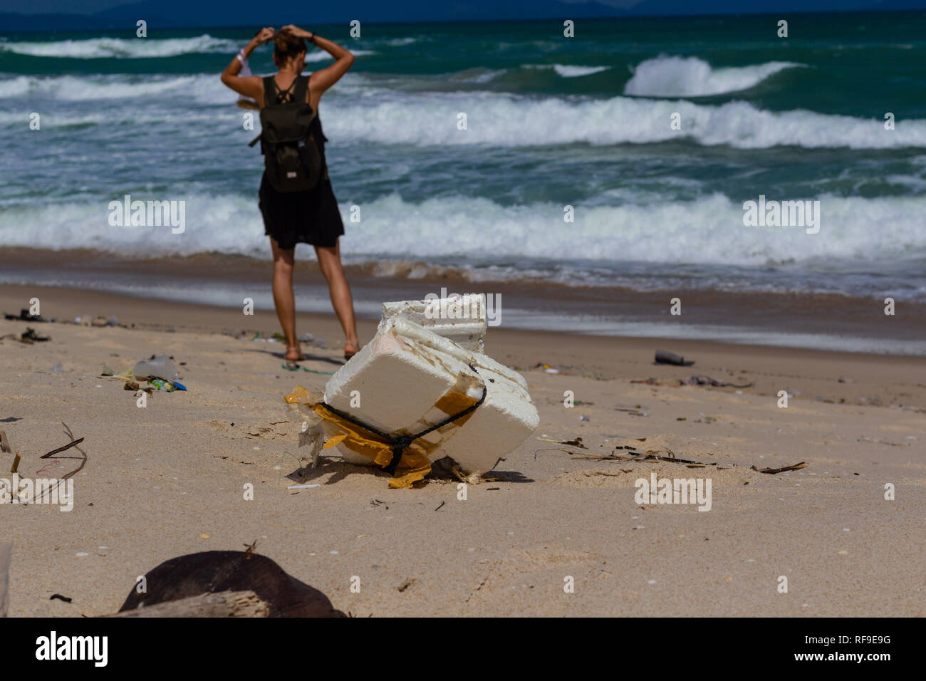 Beach pollution, plastic and waste from ocean on the beach. tourist on the polluted beach. - Stock Image