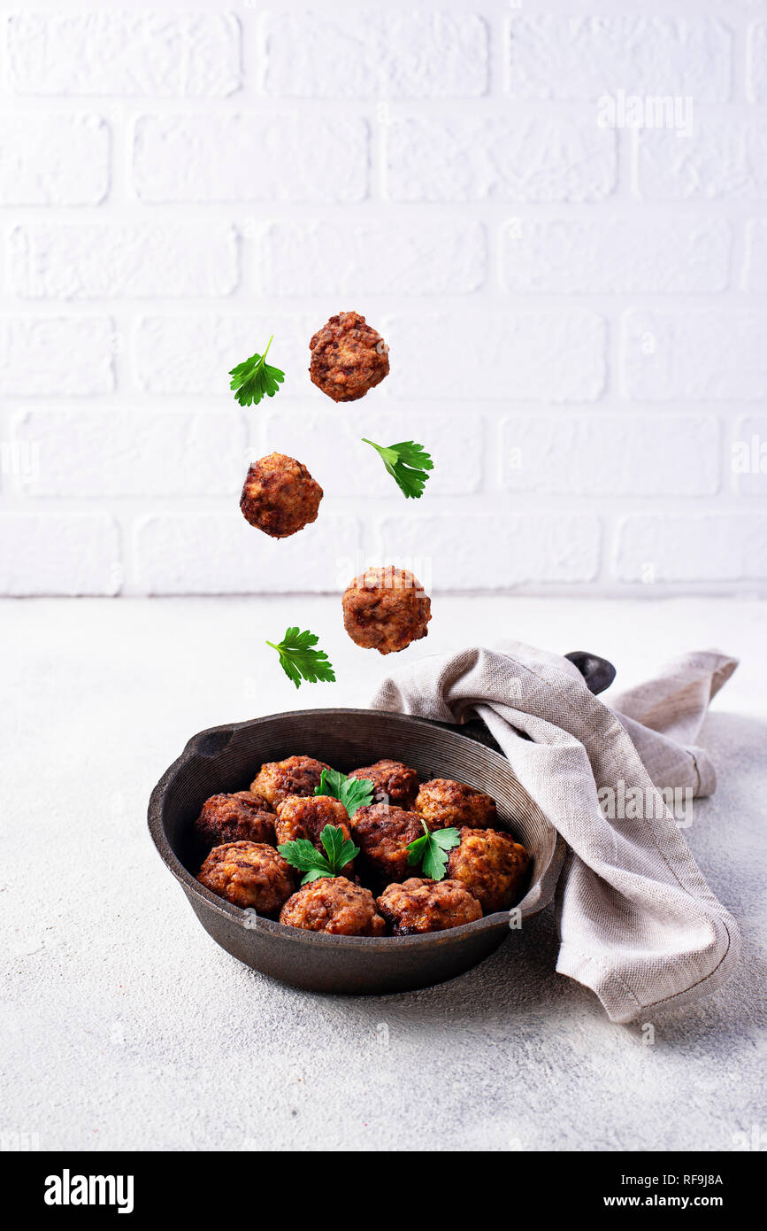 Homemade beef meatballs in frypan - Stock Image