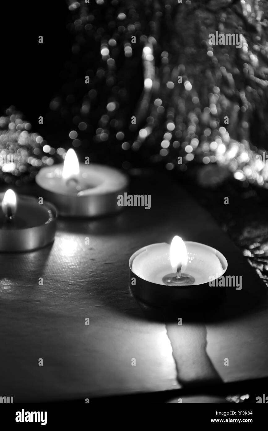 Beautiful Tea candle light view in darkness - Stock Image