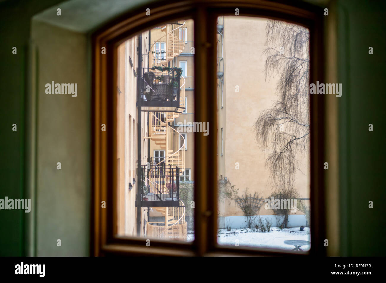 old wooden window frame in old apartment building - Stock Image
