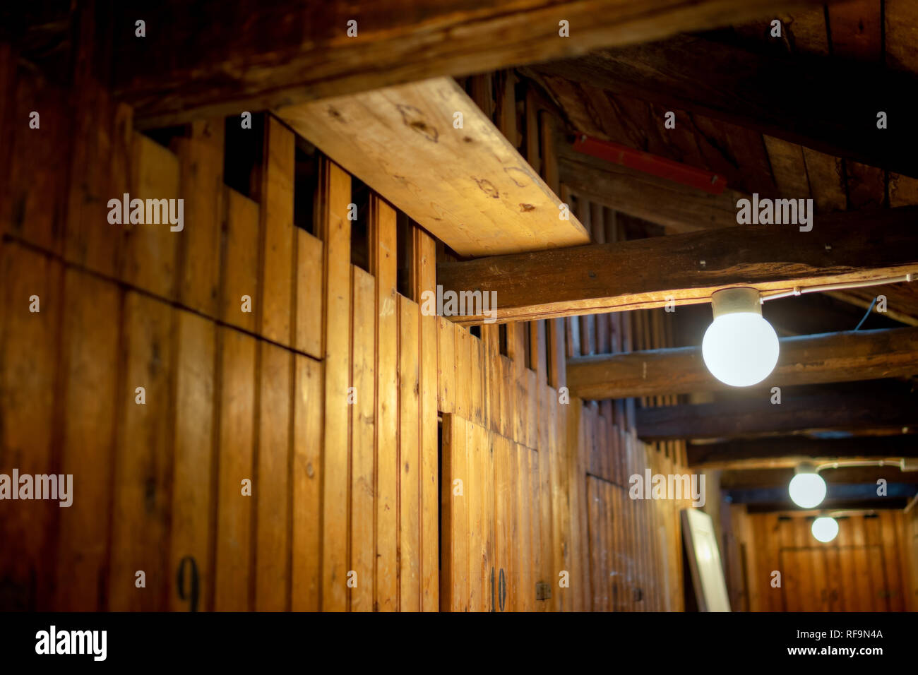 attic in old apartment building with storage space for tenants - Stock Image