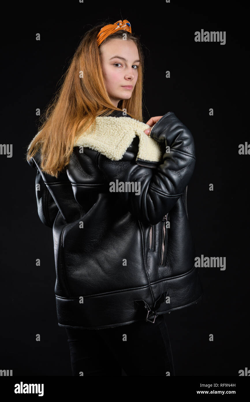 young girl posing in studio, black background Stock Photo