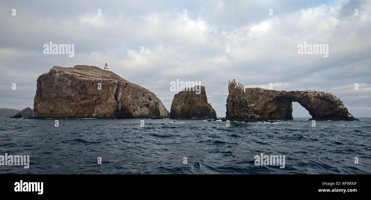 Lighthouse and Arch Rock of Anacapa Island of the Channel Islands National Park off the gold coast of California United States - Stock Image