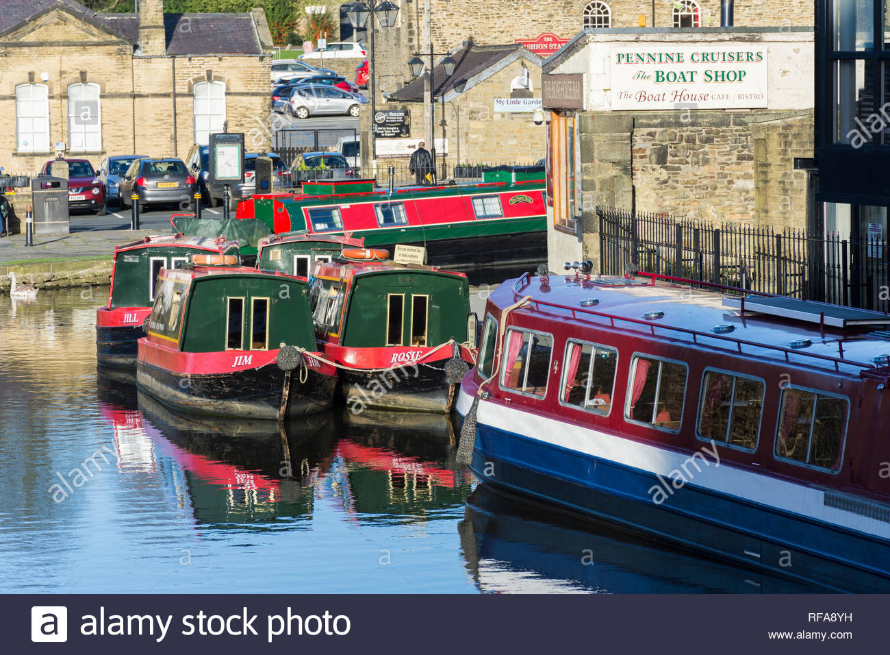 Canal boats outside Pennine Cruisers Boat Shop and the Boat House in Skipton, North Yorkshire, England, UK - Stock Image