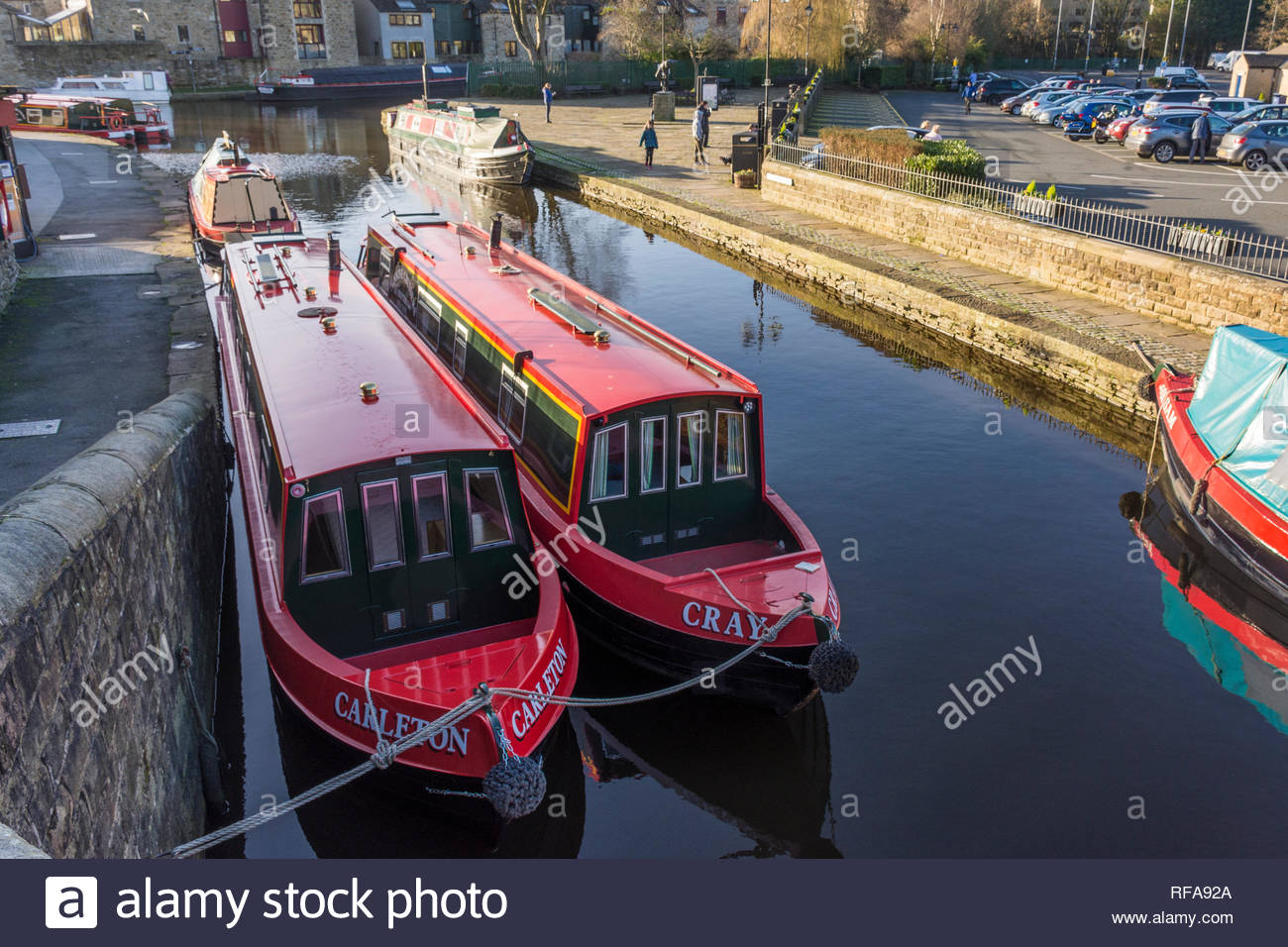 Narrowboats for hire on the Leeds and Liverpool Canal at Skipton, North Yorkshire, England, UK - Stock Image