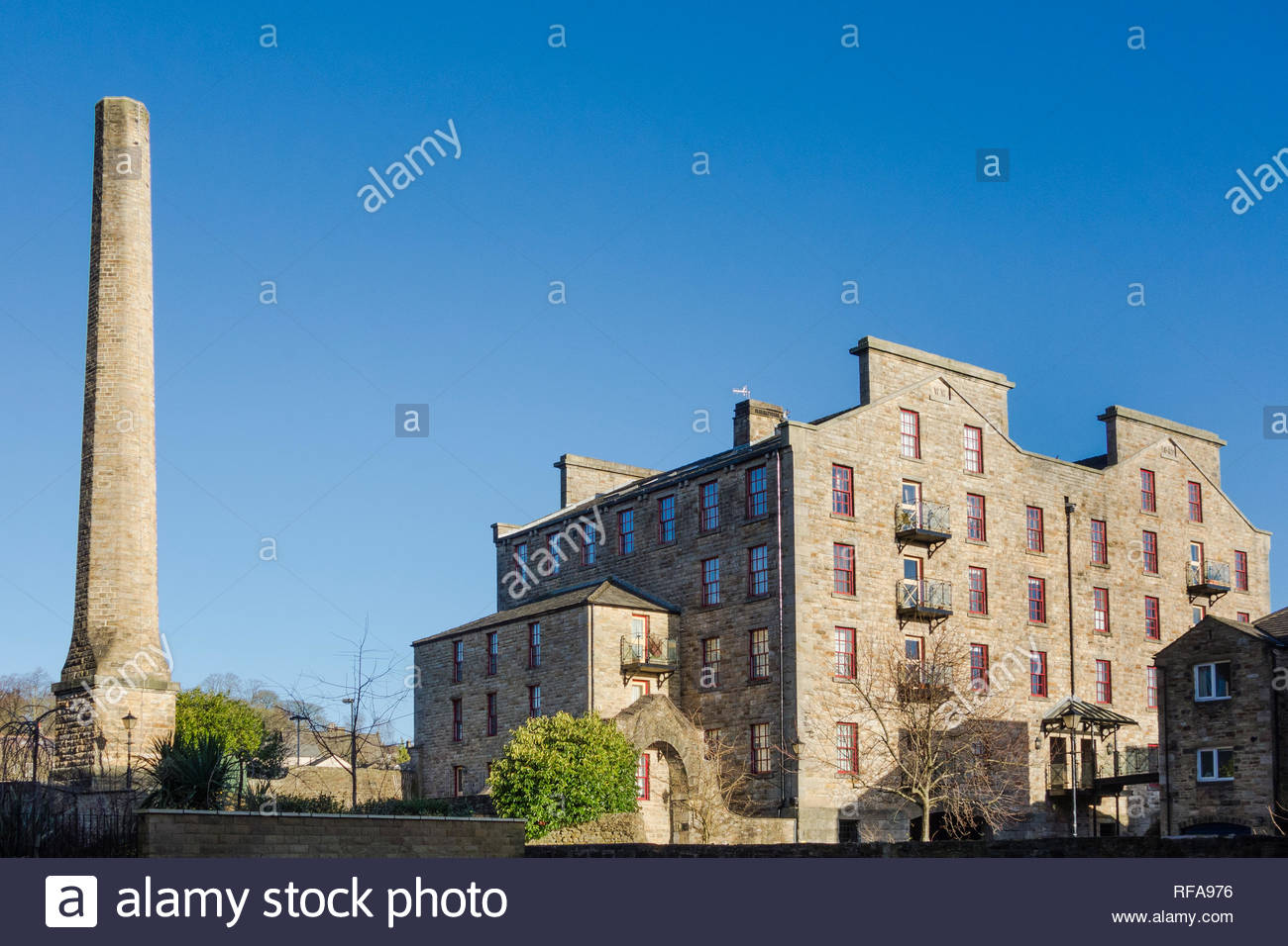 Industrial heritage and history in Skipton, North Yorkshire, England, UK with a brick chimney and a converted mill - Stock Image