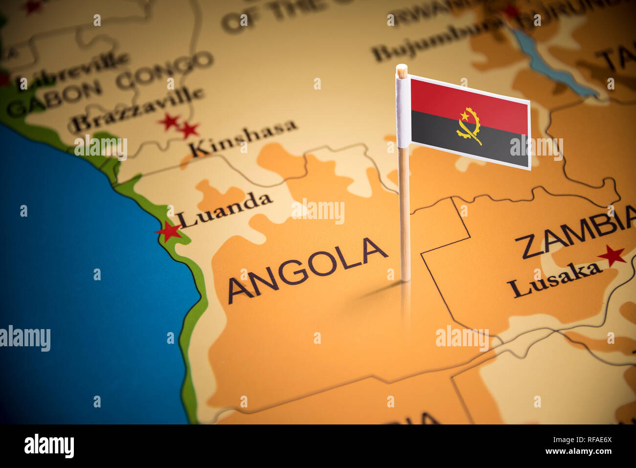 Angola marked with a flag on the map - Stock Image