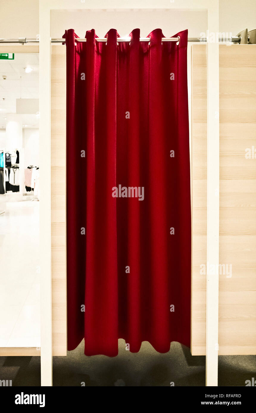 curtains of a fitting room in a clothes shop - Stock Image