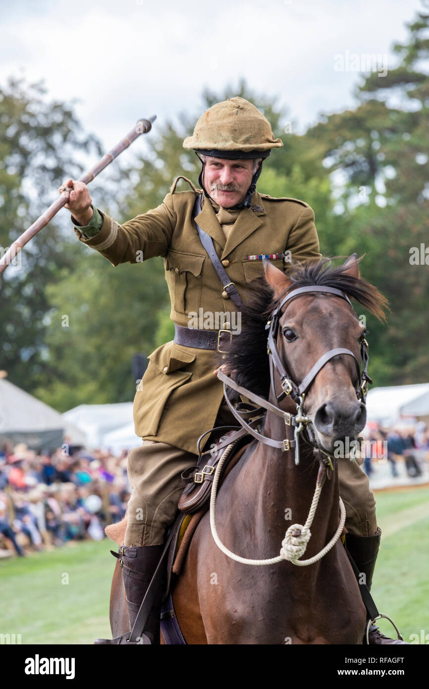 One of the contestants giving a demonstration of tent pegging on horseback at the Frampton Country Fair 2018 held at Frampton Court, Frampton on Sever - Stock Image