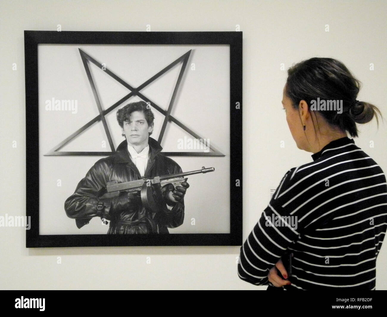 "New York, USA. 24th Jan, 2019. A visitor looks at a self-portrait of the photographer Robert Mapplethorpe in the exhibition ""Implicit Tensions: Mapplethorpe Now"" at the Guggenheim Museum. With the exception of two weeks, the exhibition can be seen from July to January 2020. (to dpa ""Guggenheim Museum shows photos of Robert Mapplethorpe in New York"" from 25.01.2019) Credit: Johannes Schmitt-Tegge/dpa/Alamy Live News Stock Photo"