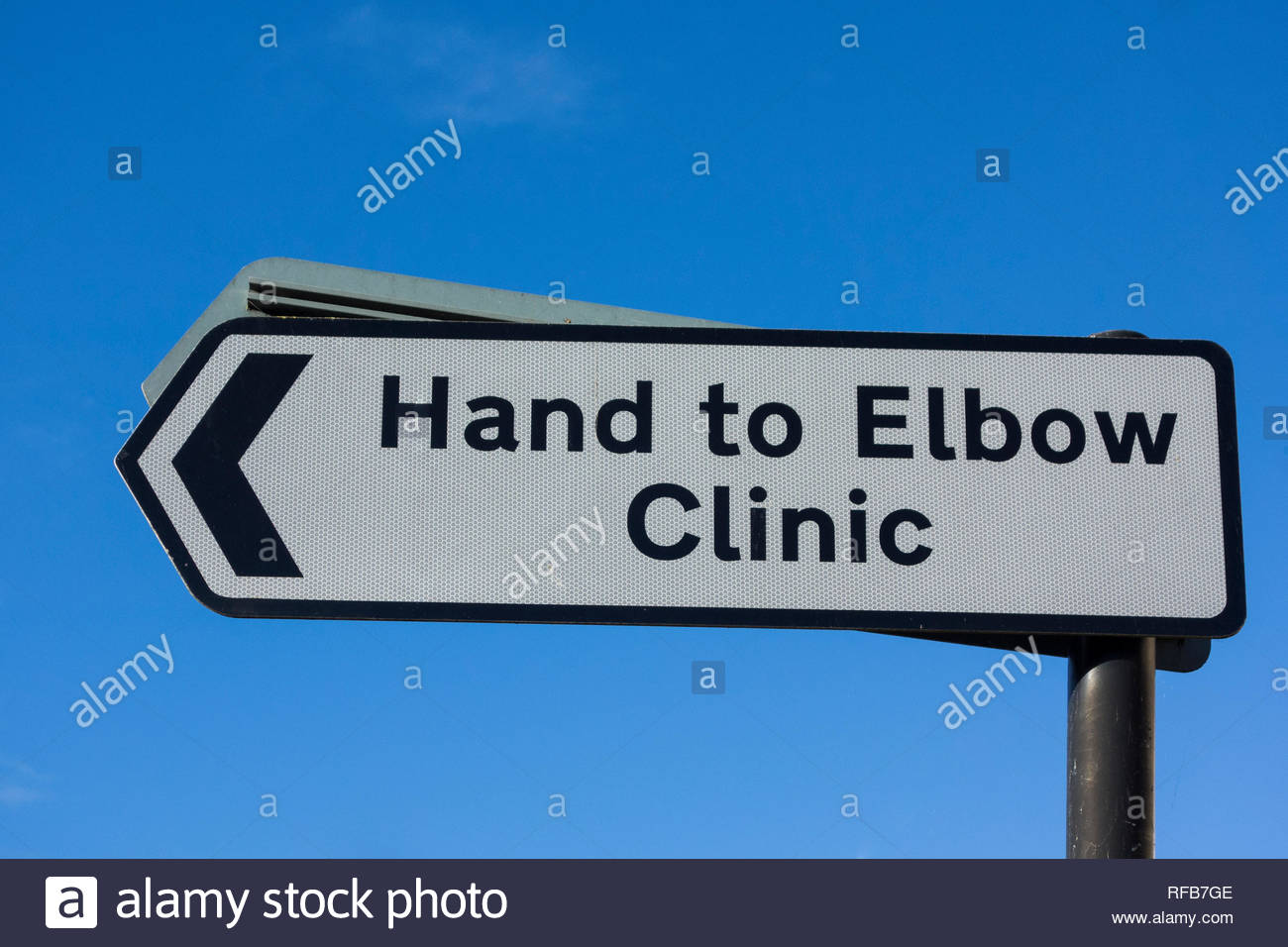 Roda sign pointing left to the Hand to Elbow Clinic in Bath, Somerset, England, UK - Stock Image