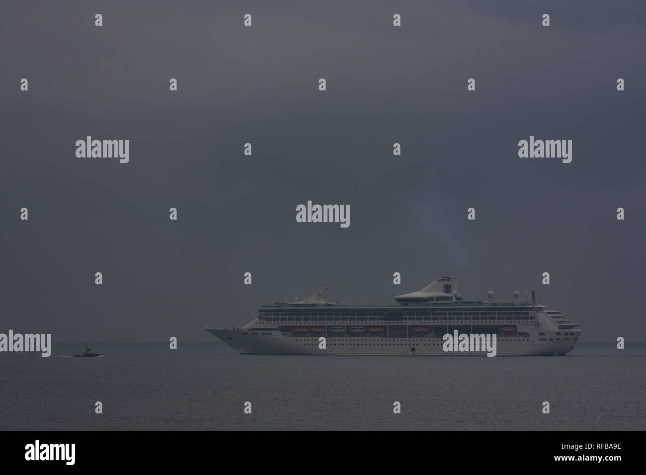 Royal Caribbean Cruises Ltd's Legend of the Seas cruise ship with pilot boat approaching, about to arrive at Hualien Port, Taiwan - Stock Image