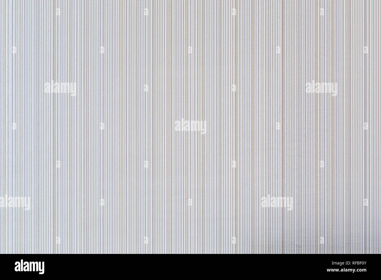 High resolution full frame background of pale and beige colored striped wallpaper. Stock Photo