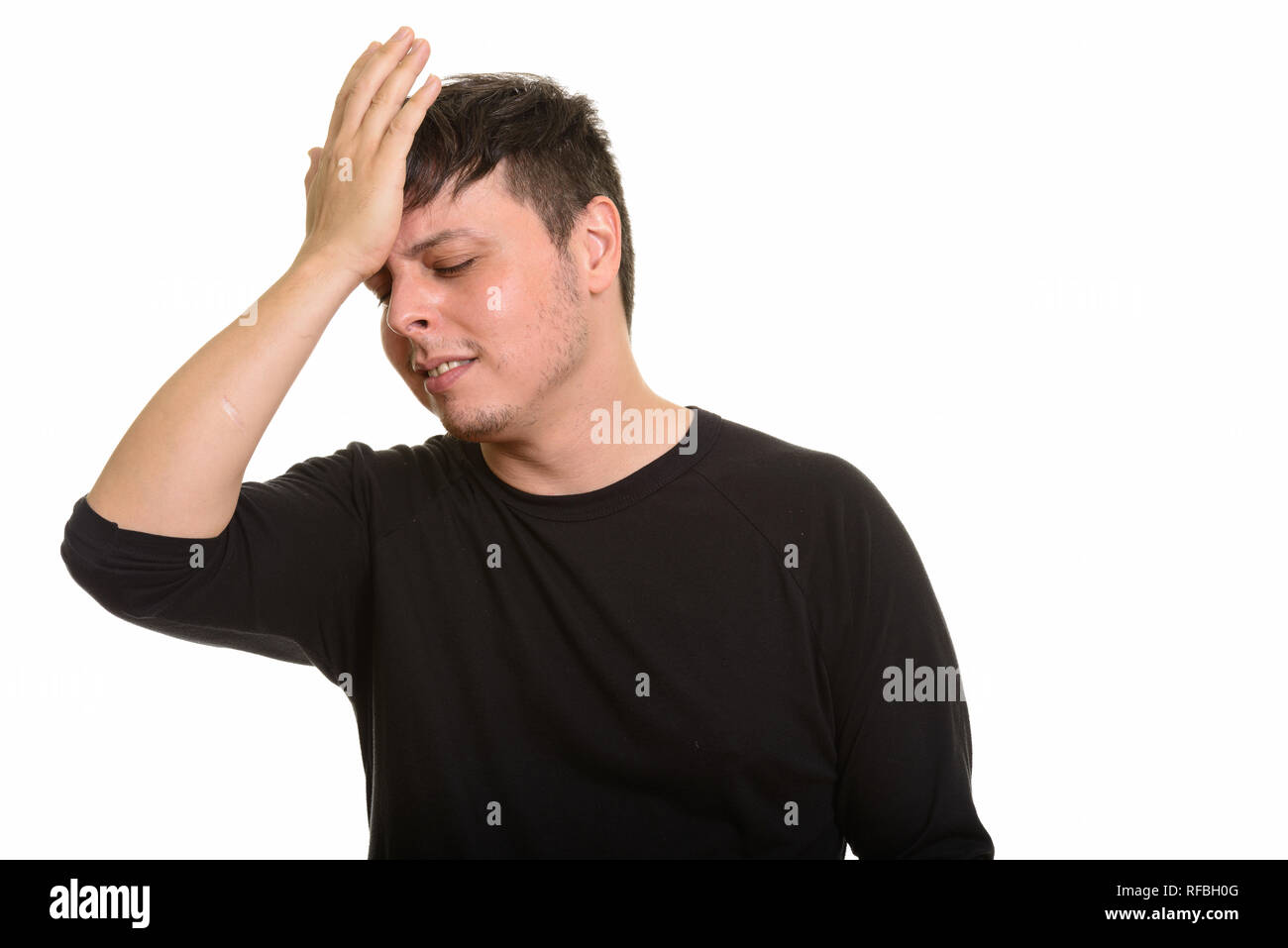 Studio shot of Caucasian man looking disappointed - Stock Image