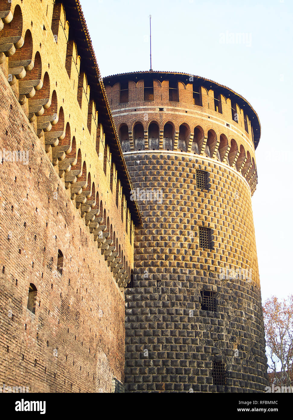 Torrione di Santo Spirito, Tower of the Holy Spirit of the Castello Sforzesco, Sforza Castle, at sunset. Milan, Lombardy, Italy. - Stock Image