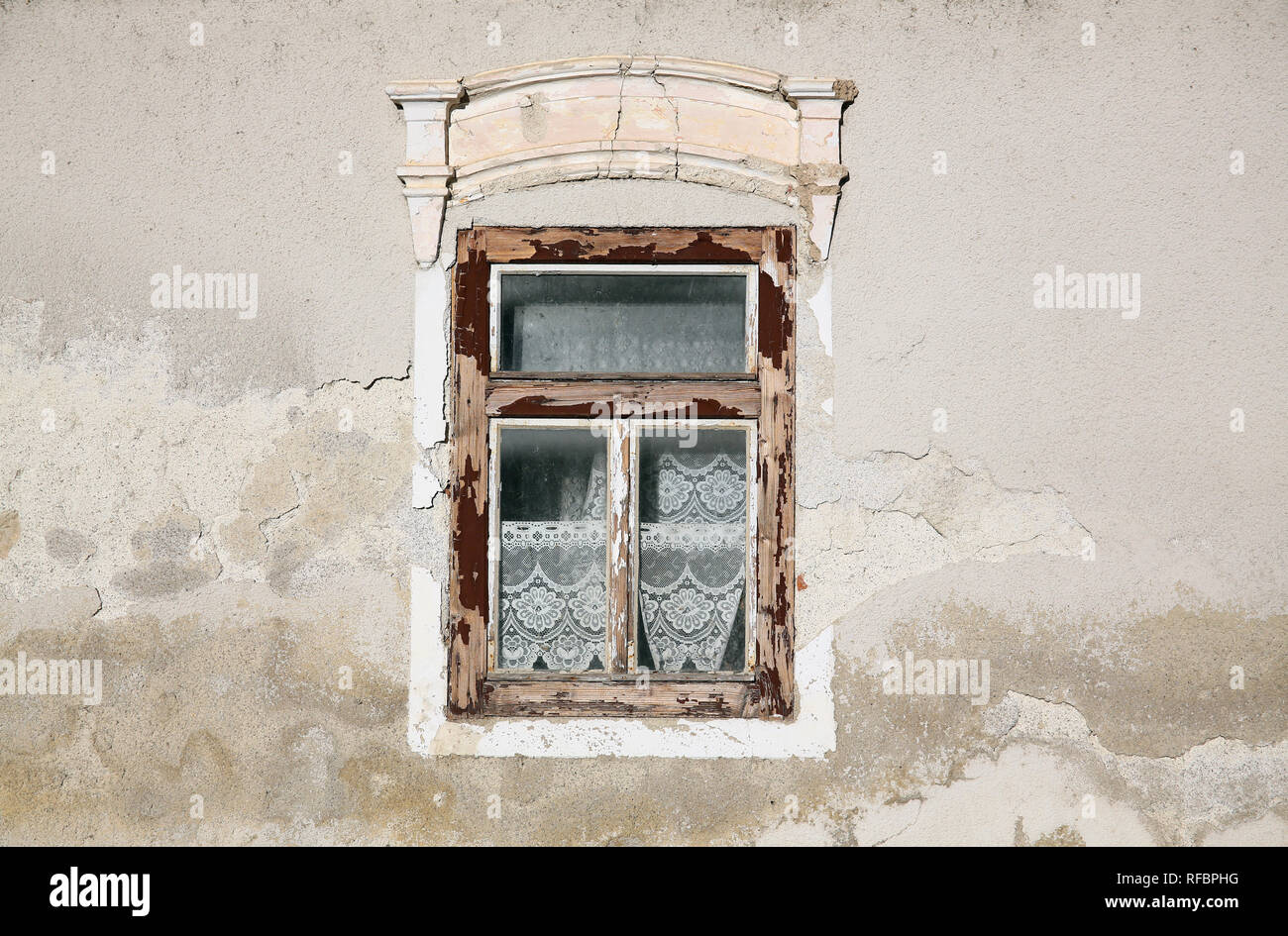 Weather worn wooden window on the house. - Stock Image