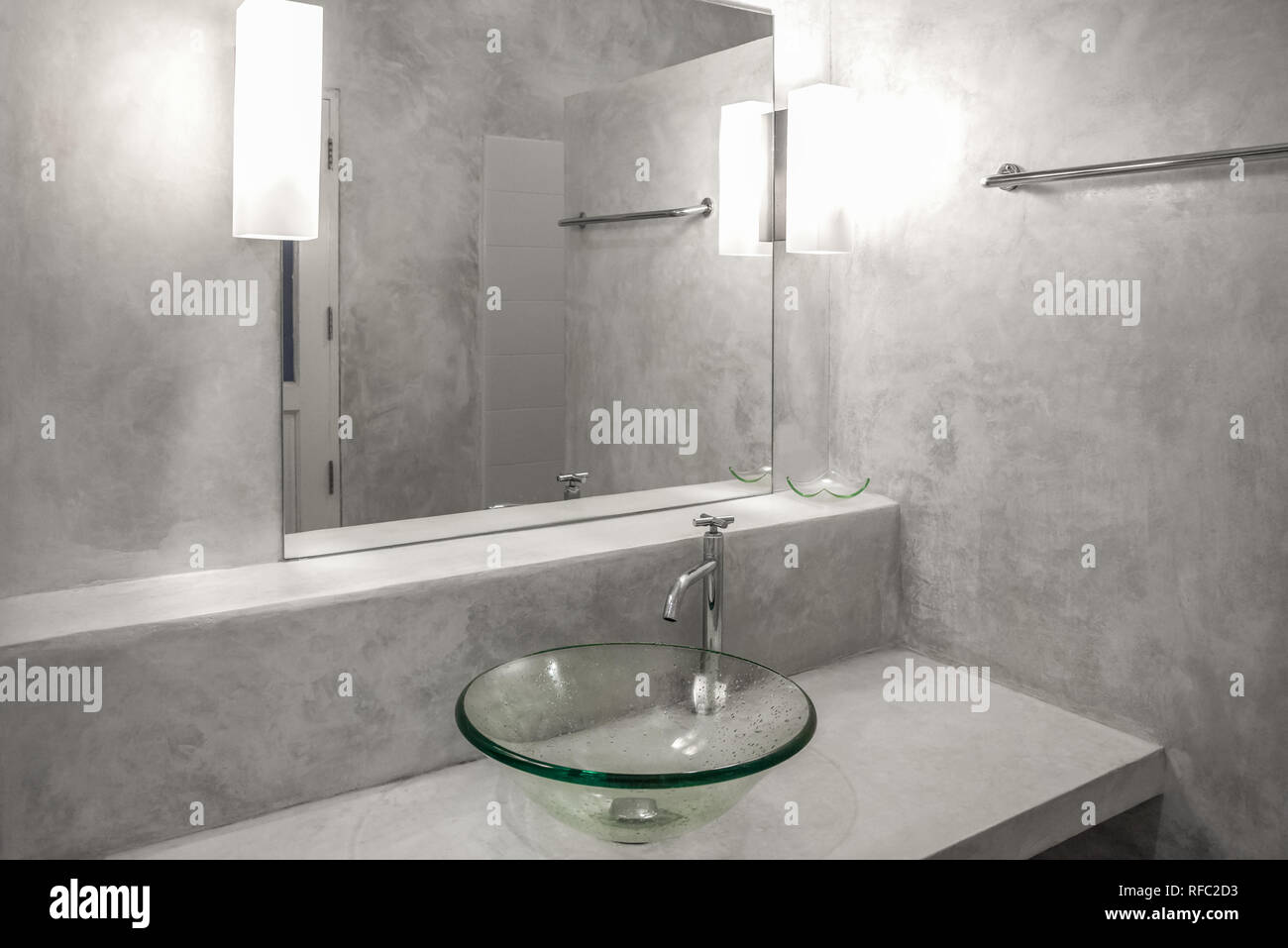 Interior of a modern bathroom. polished concrete style - Stock Image