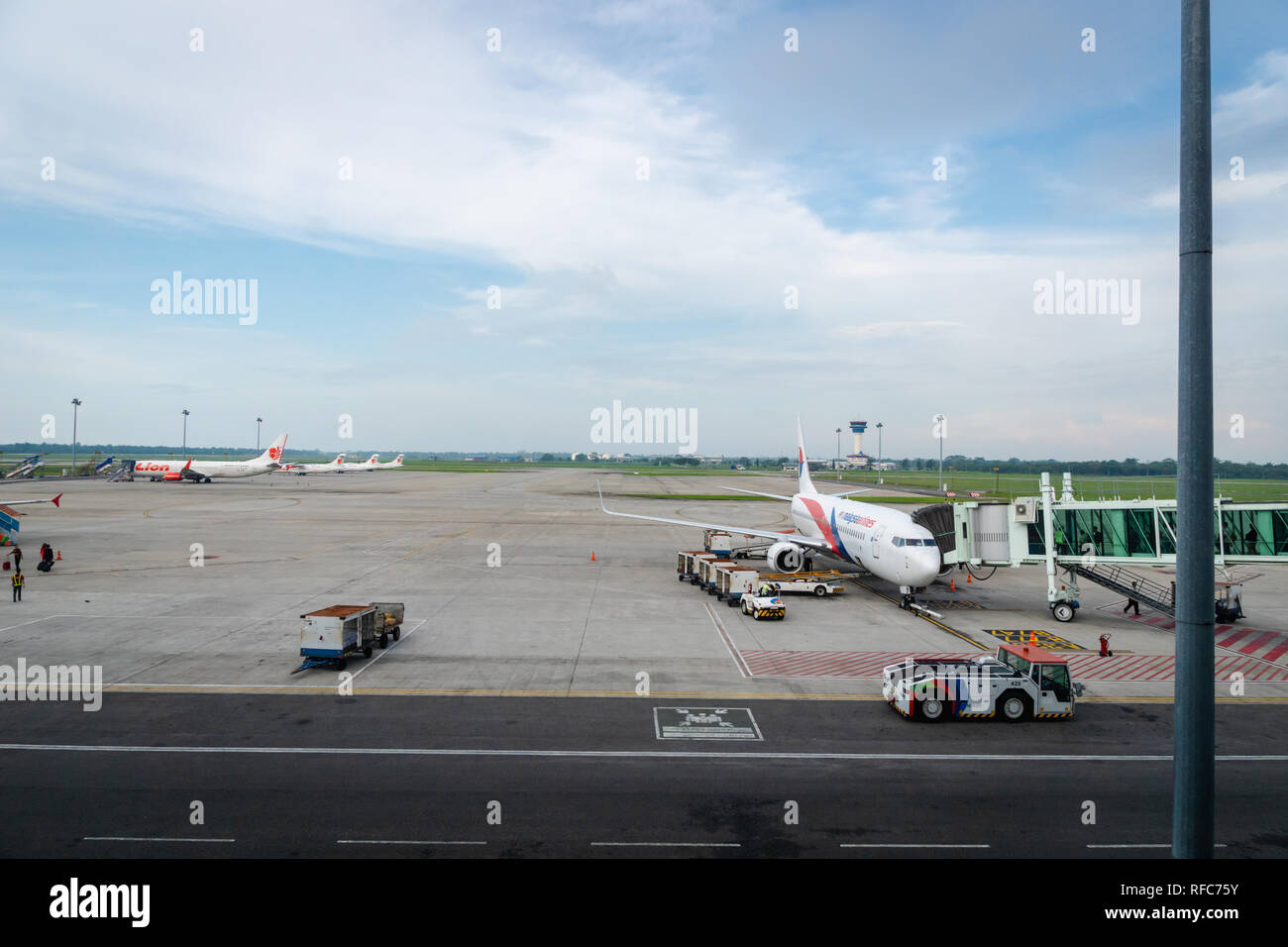 Medan, Indonesia - January 2018: aircrafts on the runway of Medan Kualanamu airport, Indonesia.   Kualanamu is the third largest airport in Indonesia. - Stock Image