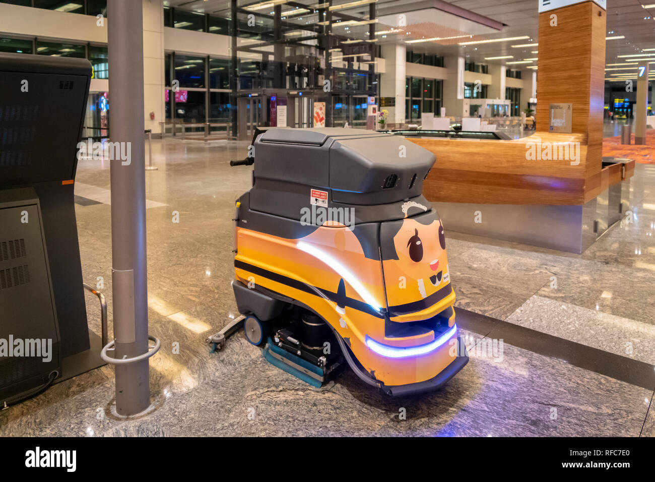 Singapore - January 2019: Cleaning robot operating automated work in Singapore Changi Airport. - Stock Image