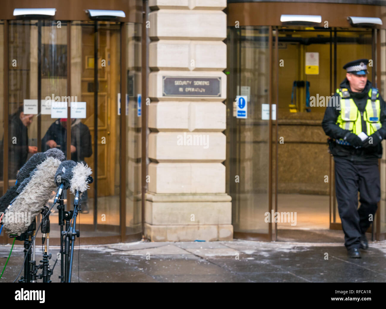 Edinburgh Sheriff Court with press microphones and policeman on duty, Edinburgh, Scotland, UK - Stock Image