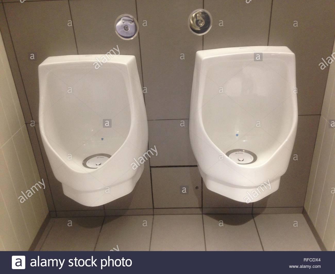 Urinals in Toronto, Ontario, Canada. - Stock Image