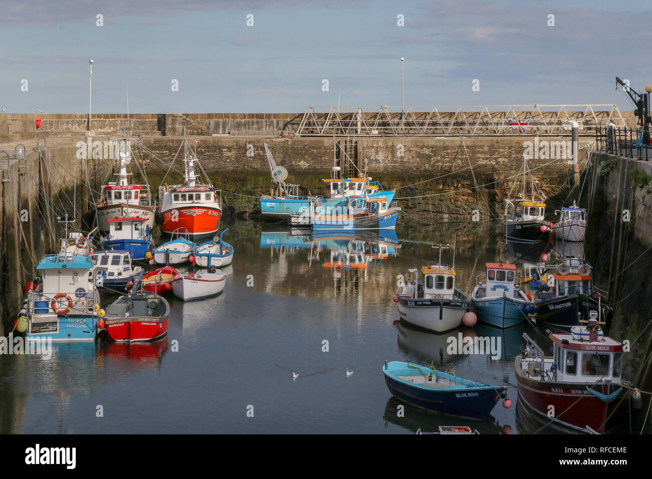 Brightly coloured fishing boats at Annalong, County Down, Northern Ireland. - Stock Image