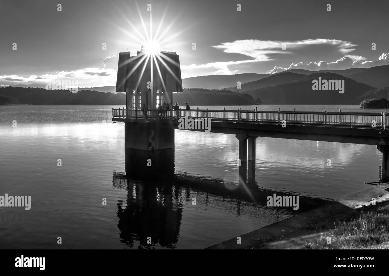 Architectural beauty hydroelectric power with sun stars sunset sky attracting tourists to visit and photograph - Stock Image