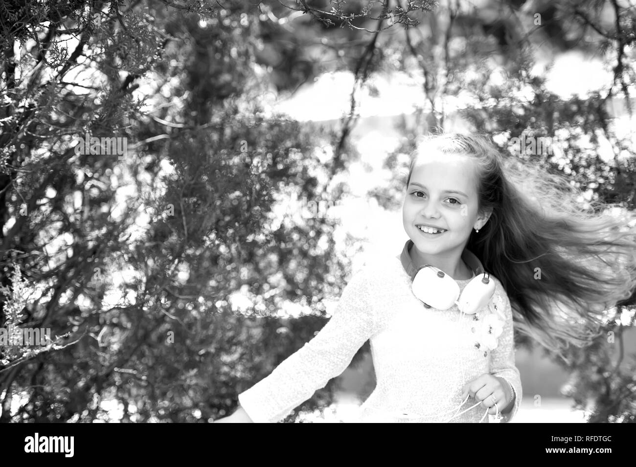 Kid dancer smile with long flying hair  Happy girl dance to music in