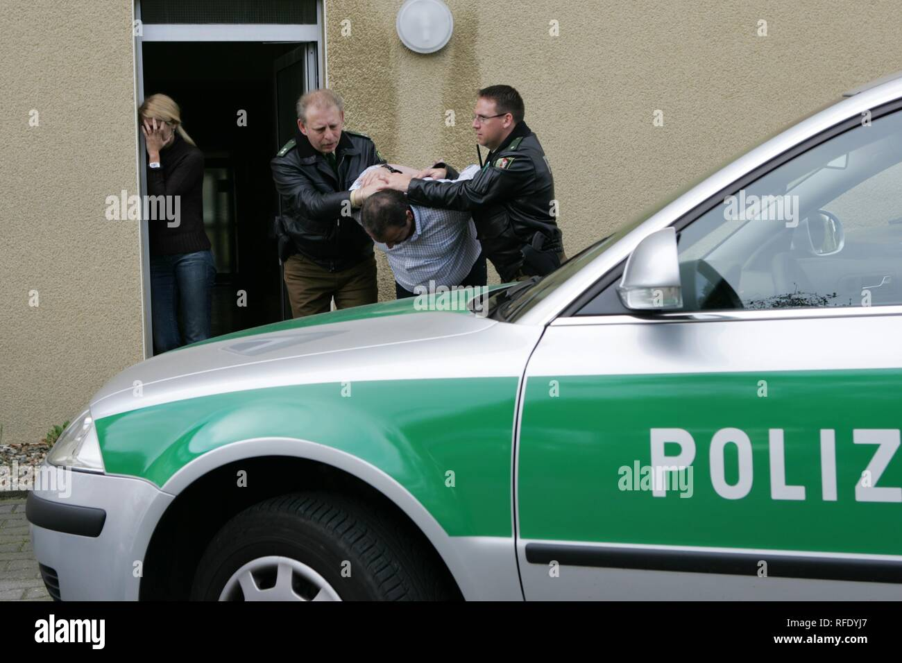 (posed situation) arrest of a violent husband, Unna, Germany - Stock Image