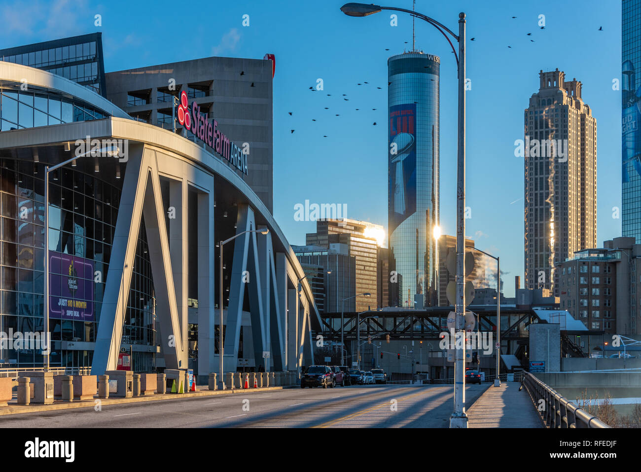 Downtown Atlanta, Georgia sunrise from the State Farm Arena with Super Bowl LIII supergraphics adorning the iconic Westin Peachtree Plaza tower. (USA) - Stock Image