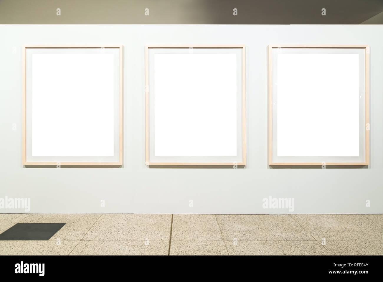 Blank empty golden frame on white background. Art gallery