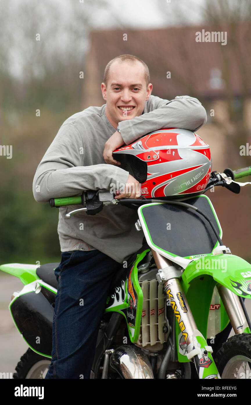 Robert Huff (Huffy) professional racing driver, relaxed holding helmet seated on a motorbike. Taken in 2005 - Stock Image