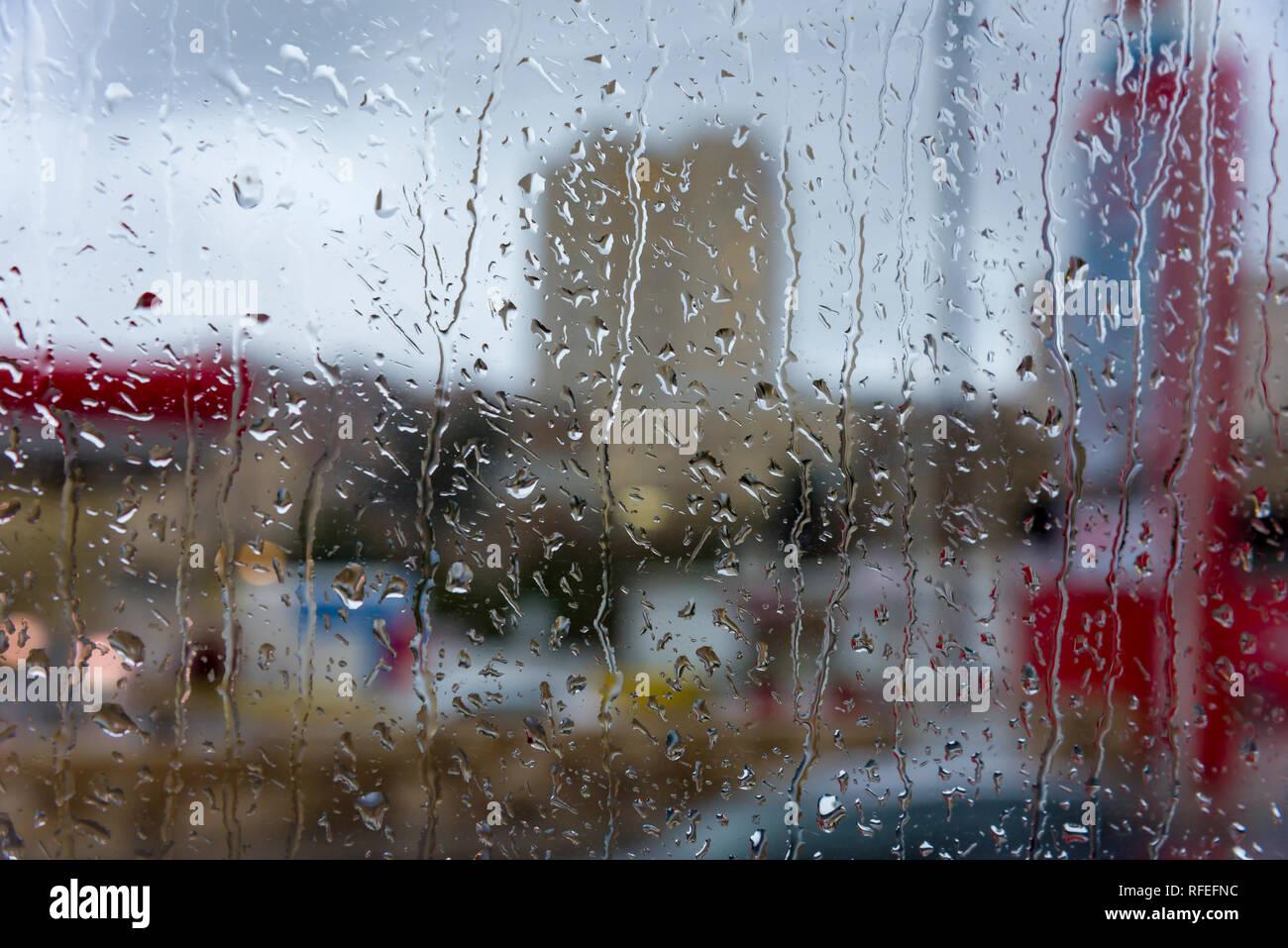 Rainy days,Rain drops on window,rainy weather,rain background,rain and bokeh Rain on the weather window. - Stock Image