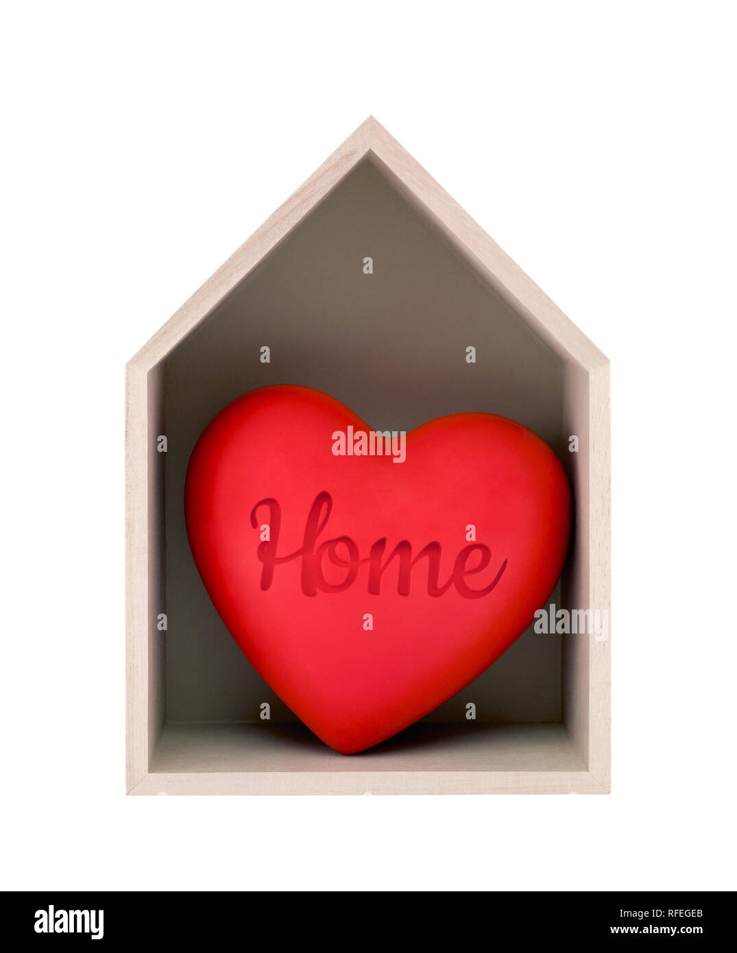 Wooden house and red heart with imprinted word home isolated on white with clipping path - Stock Image
