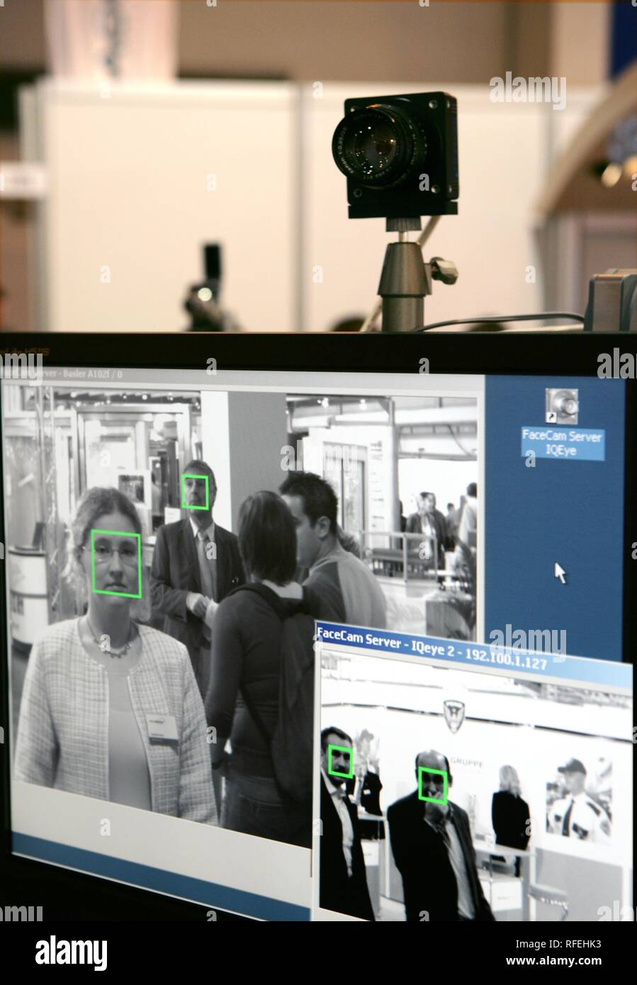 Security trade fair, world biggest trade fair of the security industry. Surveillance camera is comparing faces with database - Stock Image