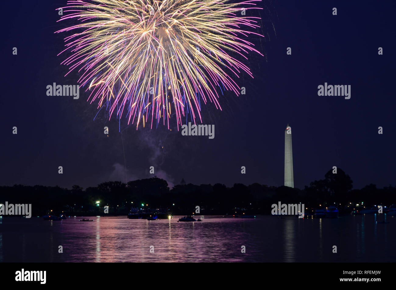 Fourth of July fireworks on the National Park tidal basin, with the Washington Monument in Washington, District of Columbia Stock Photo